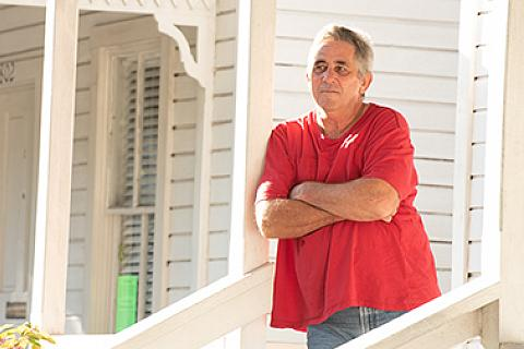 Man Standing on Front Porch